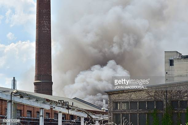 Smoke billows from a fire in a storage facility at the Dong Xuan shopping centre in Berlin's Lichtenberg district on May 11 2016 The smoke affected...