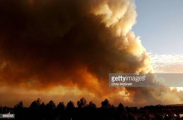 Smoke billows from a large fire December 26 2001 that threatens Sydneys Western suburbs Over 100 fires are burning across the greater Sydney area and...