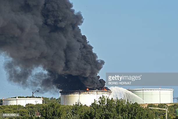 Smoke billows from a petrochemical plant operated by LyondellBasell in Berrel'Etang near Marseille in southern France on July 14 2015 A fire was...