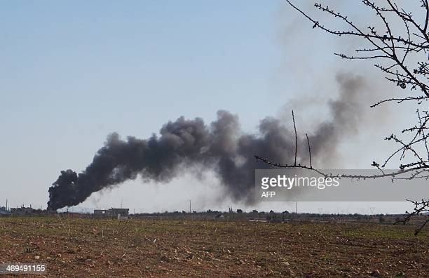 Smoke billows from a proregime position after rebel fighters fired rockets on February 14 2014 at an undisclosed location north of the Syrian city of...