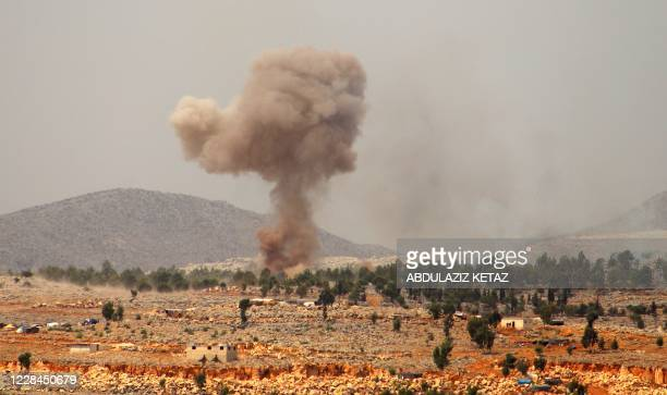 Smoke billows from a reported Russian airstrike near the village of Hafsarjah, in the western countryside of Idlib province in northwestern Syria, on...