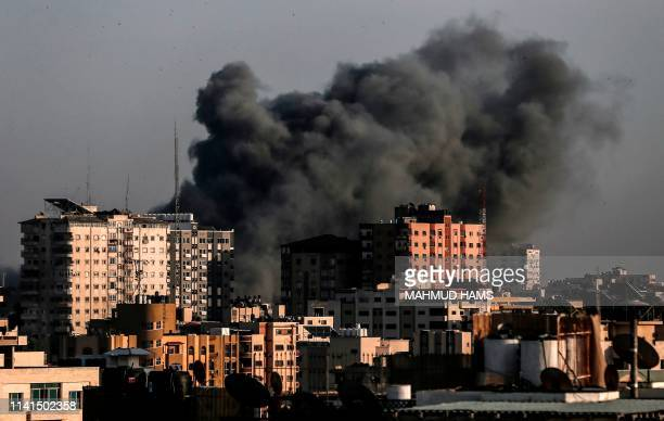 TOPSHOT Smoke billows from a targeted neighbourhood in Gaza City during an Israeli airstrike on the Hamasrun Palestinian enclave on May 5 2019 Gaza...