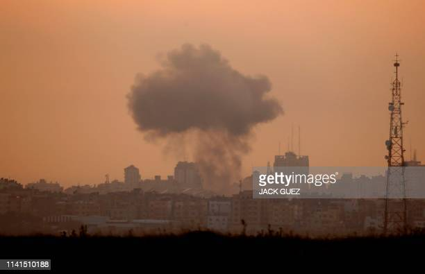 Smoke billows from a targeted neighbourhood in Gaza City during an Israeli airstrike on the Hamas-run Palestinian enclave on May 5, 2019. - Gaza...