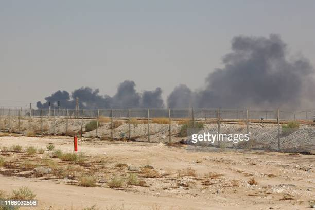 Smoke billows from an Aramco oil facility in Abqaiq about 60km southwest of Dhahran in Saudi Arabia's eastern province on September 14 2019 Drone...