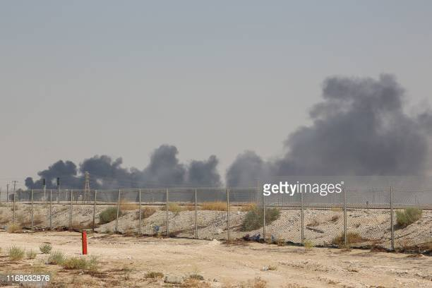 TOPSHOT Smoke billows from an Aramco oil facility in Abqaiq about 60km southwest of Dhahran in Saudi Arabia's eastern province on September 14 2019...