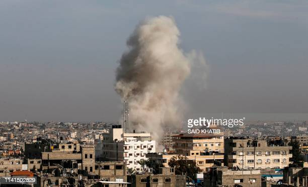 TOPSHOT Smoke billows from an area targeted by Israeli air strikes in the Palestinian city of Rafah in the southern Gaza Strip on May 5 2019 Israel's...