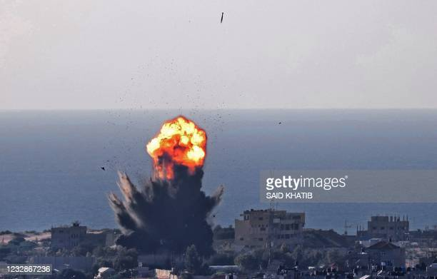 Smoke billows from an explosion as another air bomb falls during an Israeli air strike in Rafah in the southern Gaza Strip on May 13, 2021.