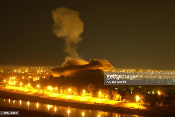 Smoke billows from an explosion in Iraqi President Saddam Hussein's presidential palace in Baghdad during a coalition air raid early 02 April 2003...