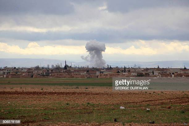 Smoke billows from an Islamic State group position following an air strike by Syrian progovernment forces in the Hatabat alBab area near town of...