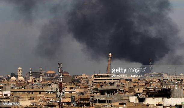 Smoke billows from behind the Great Mosque of alNuri in Mosul's Old City on April 17 during an offensive by Iraqi security forces to recapture the...