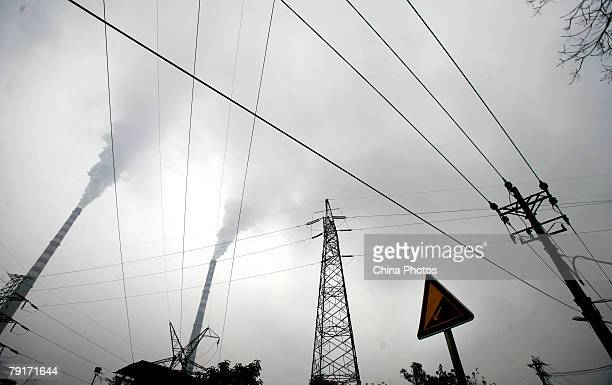 Smoke billows from chimneys at the Chongqing Power Plant on January 23, 2008 in Chongqing Municipality, China. China is experiencing a 69.63 million...