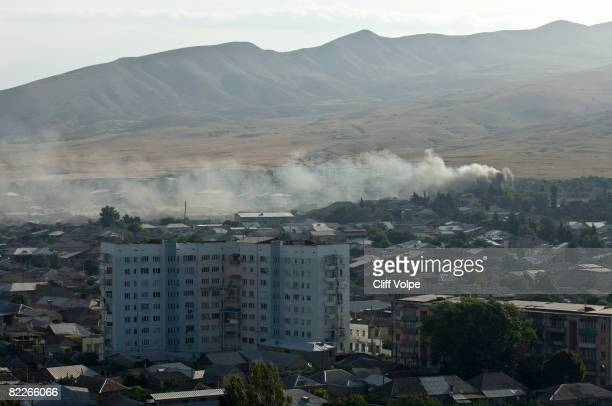 Smoke billows from civilian apartment buildings that were bombed by Russian jets August 11 2008 in Gori Georgia Russian forces have advanced into...