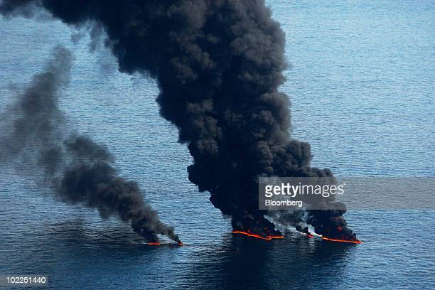 Smoke billows from controlled burns of oil on the surface of the water near the site of the BP Plc Deepwater Horizon oil spill in the Gulf of Mexico...