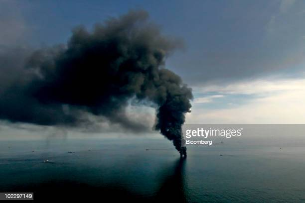 Smoke billows from controlled oil burns near the site of the BP Plc Deepwater Horizon oil spill in the Gulf of Mexico off the coast of Louisiana US...
