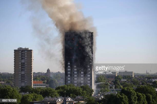 Smoke billows from Grenfell Tower as firefighters attempt to control a huge blaze on June 14 2017 in west London The massive fire ripped through the...