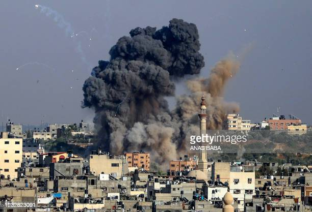 Smoke billows from Israeli air strikes in Gaza City, controlled by the Palestinian Hamas movement, on May 11, 2021. - Israel and the Islamist...
