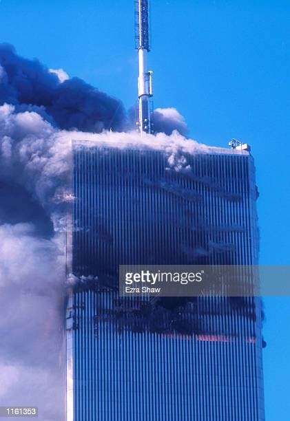 Smoke billows from one of the World Trade Center's twin towers after it was struck by a commerical airliner in a suspected terrorist attack September...