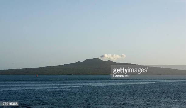 Smoke billows from Rangitoto Island in a mock eruption as Marc Ellis launches his new business Mintshotconz at Okahu November 15 2007 in Auckland New...