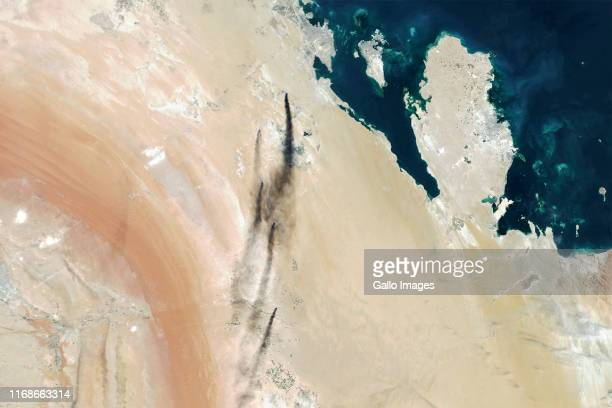 Smoke billows from Saudi Aramco's oil processing plants in Abqaiq and Khurais Saudi Arabia