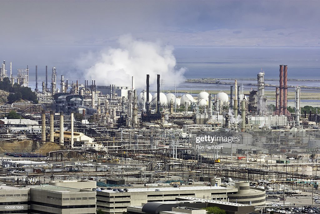 CONTENT] Smoke billows from stacks at the Chevron refinery in Richmond, California. The photographer's location was Nicholl Knob in Point Richmond.