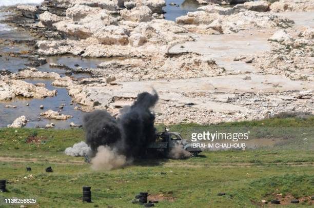 Smoke billows from targets hit by A29 Super Tucano military aircrafts during a drill by the Lebanese Airforce in the northern Lebanese village of...