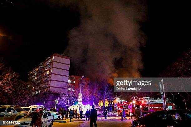 Smoke billows from the blast site as Turkish army service busses burn after an explosion on February 17 2016 in Ankara Turkey 21 people are believed...