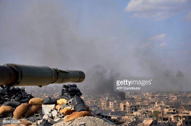 Smoke billows from the eastern city of Deir Ezzor during an operation by Syrian government forces against Islamic State group jihadists on November 2...