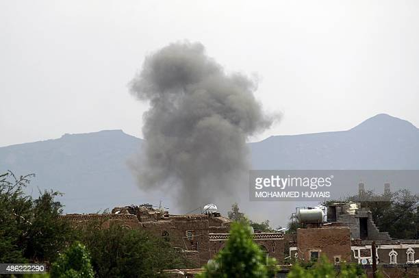 Smoke billows from the military college in the Yemeni capital Sanaa during a Saudiled coalition air strike on September 2 2015 The coalition which...