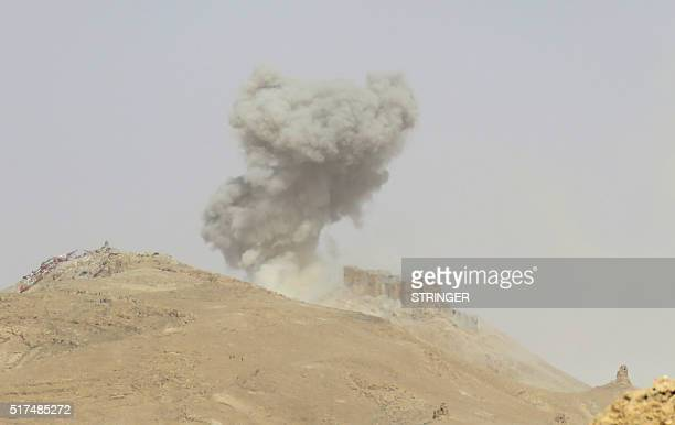 Smoke billows from the Palmyra citadel on March 25 during a military operation by Syrian troops to retake the ancient city from the jihadist Islamic...