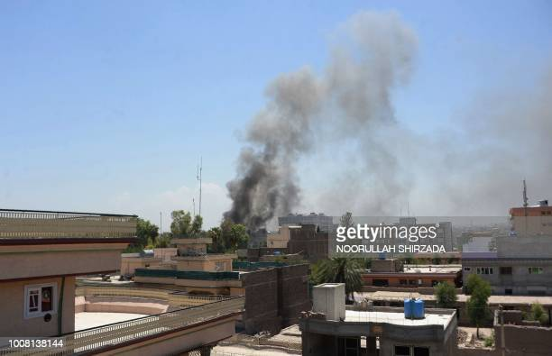 Smoke billows from the site of suicide attack during an ongoing attack between Afghan security force and suicide attackers in Jalalabad on July 31...
