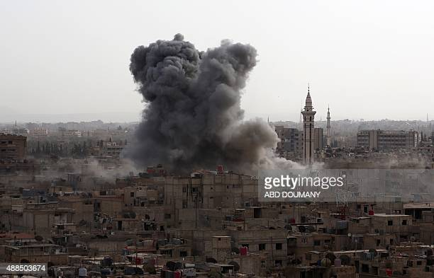 Smoke billows from the Syrian rebelheld area of Douma east of the capital Damascus following a reported air strike by government forces on September...