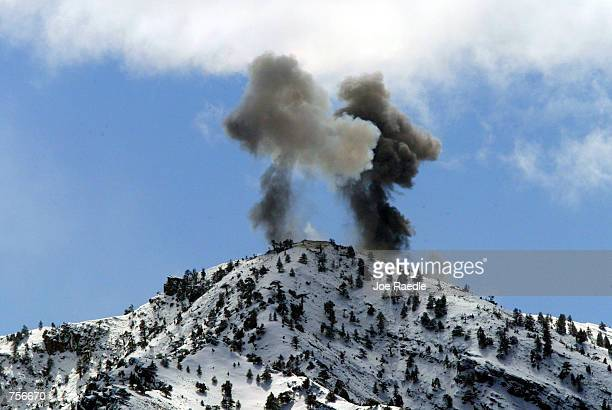 Smoke billows from the top of a mountain after air strikes on a suspected enemy position by United States Airforce B52 bombers March 10 2002 near the...