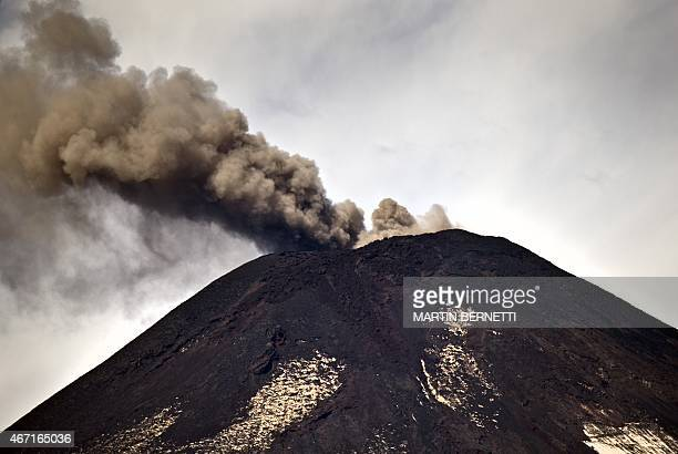 Smoke billows from the Villarrica volcano near Pucon in southern Chile on March 21 2015 as it shows renewed activity two weeks after its eruption...