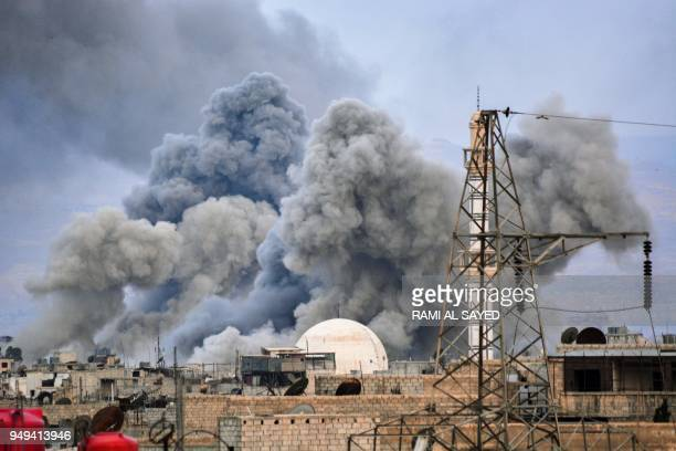 Smoke billows in a southern district of the Syrian capital Damascus during regime strikes targeting the Islamic State group in the Palestinian camp...
