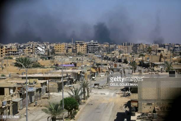 Smoke billows in Raqa's western al-Darya neighbourhood, on August 14 as Syrian Democratic Forces , a US backed Kurdish-Arab alliance, battle to...