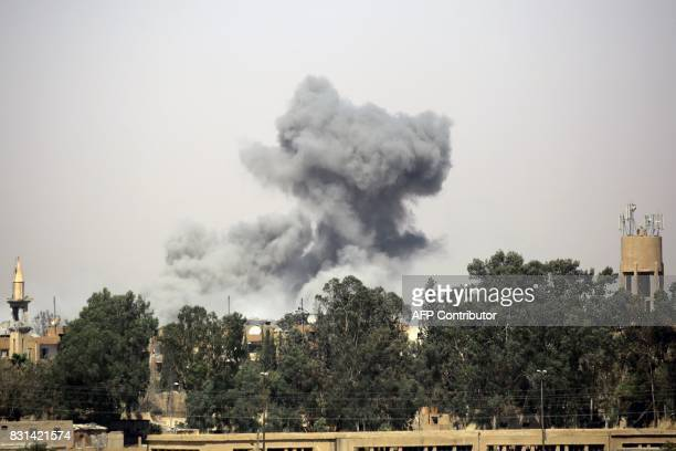 Smoke billows in Raqa's western alDarya neighbourhood on August 14 as Syrian Democratic Forces a US backed KurdishArab alliance battle to retake the...