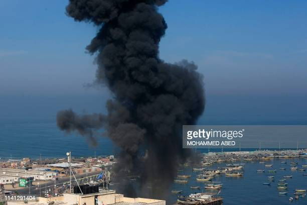 Smoke billows in the area overlooking Gaza City's main port during an Israeli airstrike on the Hamasrun Palestinian enclave on May 5 2019 Gaza...