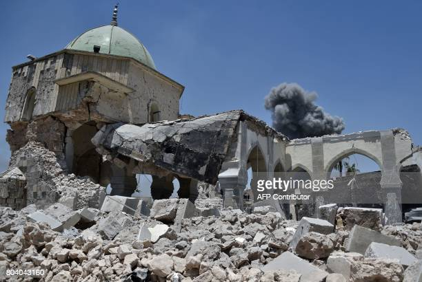 Smoke billows in the background behind the destroyed AlNuri Mosque in the Old City of Mosul after the area was retaken from IS on June 30 2017...