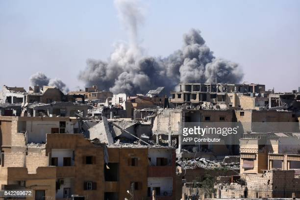 Smoke billows in the embattled northern Syrian city of Raqa on September 3 as Syrian Democratic Forces a US backed KurdishArab alliance battle to...