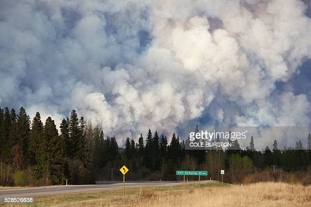 Smoke billows in the sky near Fort McMurray Alberta seen down Highway 63 on May 5 2016 The Province of Alberta has issued a State of Emergency as...