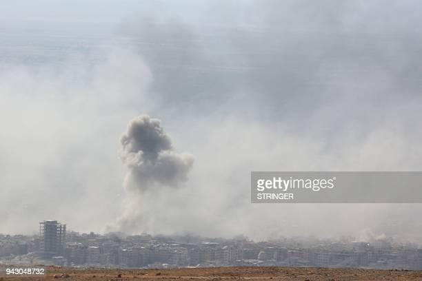TOPSHOT Smoke billows in the town of Douma the last opposition holdout in Syria's Eastern Ghouta on April 7 after Syrian regime troops resumed a...