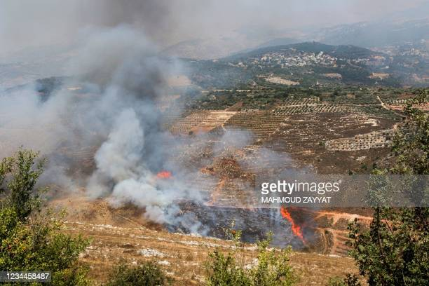 Smoke billows in the towns of Ibl Al-Saqi and Kfar Hamam in southern Lebanon, from shelling by Israeli forces on August 4, 2021. - Rocket fire from...