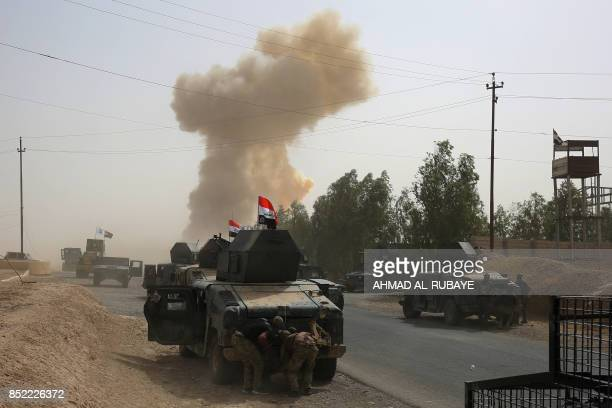 Smoke billows on September 23, 2017 following a car bomb explosion as Iraqi forces advance to recapture the insurgent stronghold of Hawija after...