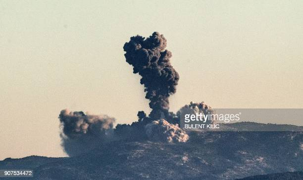 TOPSHOT Smoke billows on the Syrian side of the border at Hassa near Hatay southern Turkey on January 20 2018 as Turkish jet fighters hit the...