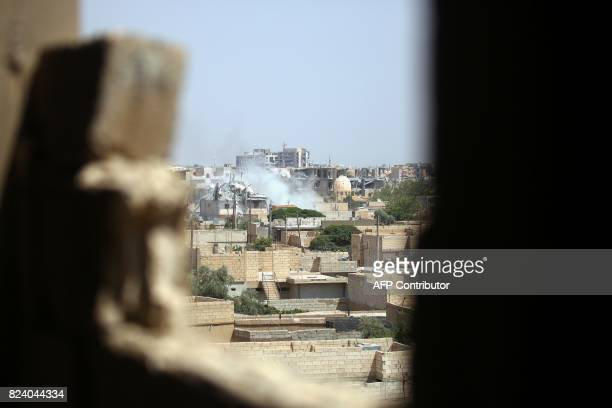 Smoke billows out from Raqa following a coalition air strike on July 28 2017 The Syrian Democratic Forces a USbacked KurdishArab alliance has ousted...