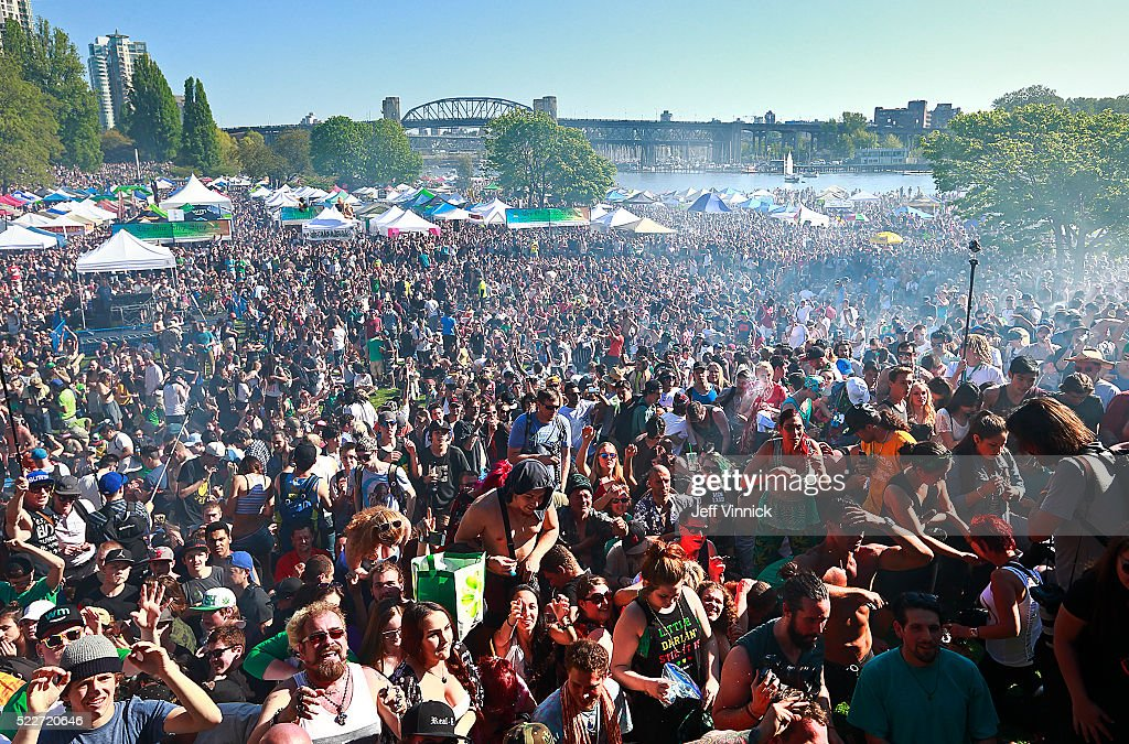 Smoke billows over a crowd of thousands of people as they smoke at 4:20pm during 4/20 celebrations on April 20, 2016 at Sunset Beach in Vancouver, Canada. The Vancouver 4/20 event is the largest free protest festival in the city, with day-long music, public speakers and the world's only open-air public cannabis farmer's market where people sell all kinds of cannabis and extracts while educating the crowd about medical marijuana, political involvement and activism. Canadian Federal Health Minister Jane Philpott says Canada will roll out the legislation in the spring of 2017 to begin the process of legalizing and regulating marijuana.