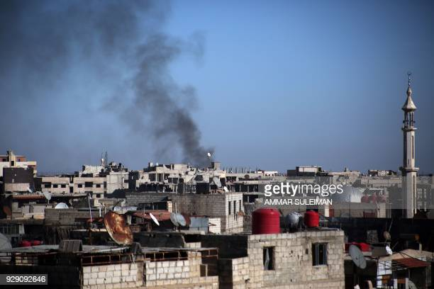 Smoke billows over Kafar Batna in the Syrian rebel enclave of Eastern Ghouta on March 7 following reported air strikes by Syrian government forces /...