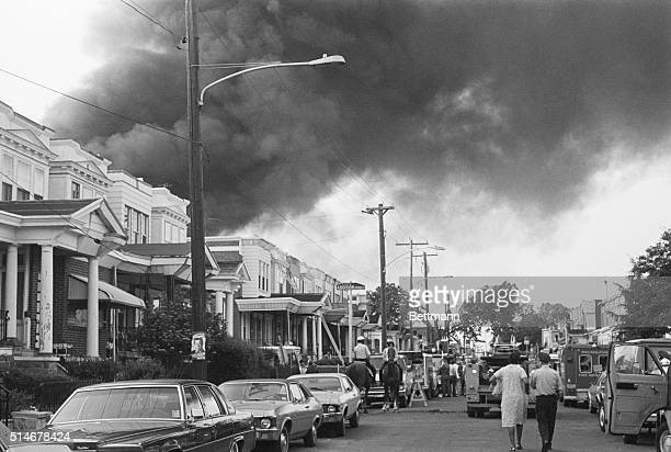 Smoke billows over rowhouses in the West Philadelphia after the police bombed the home of the radical African American organization MOVE during a...