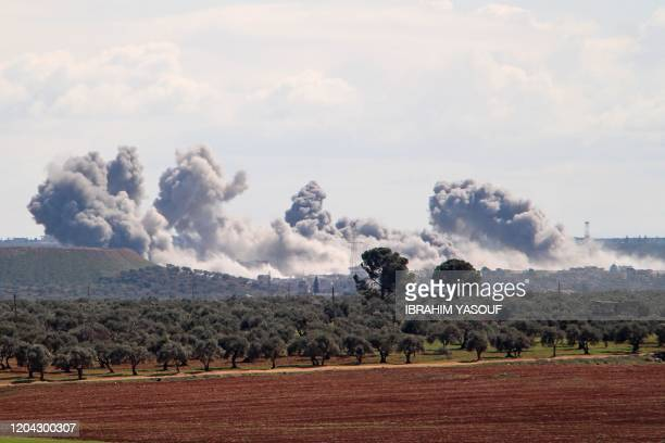 Smoke billows over the village of Qaminas, about 6 kilometres southeast of Idlib city in northwestern Syria, following reported Russian air strikes...
