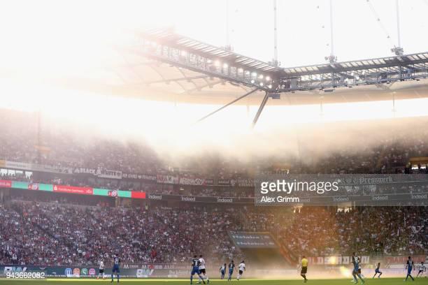 Smoke billows through the stadium during the Bundesliga match between Eintracht Frankfurt and TSG 1899 Hoffenheim at CommerzbankArena on April 8 2018...